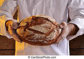 holding fresh bread