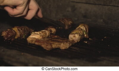 Cook in restaurant fries steak or beefsteak and pieces of...