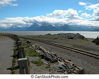 Beautiful Cook Inlet near Anchorage, Alaska is surrounded by mountain peaks.