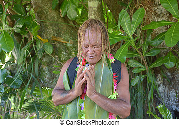 Cook Islander blessing on Noni Juice during Eco tourism tour...