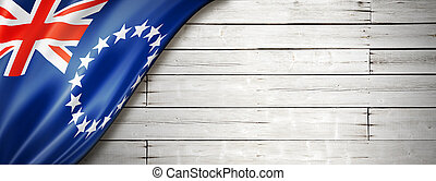 Cook Islands flag on old white wall banner