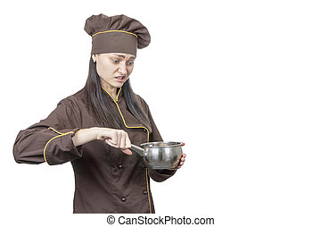 cook looks at the pan