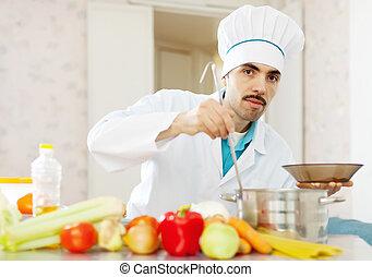 cook man cooking vegetarian lunch
