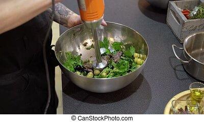 Cook mixing salad