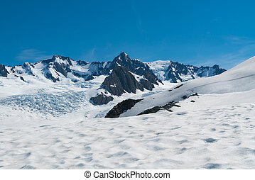 Cook Mount with snow landing and clear blue sky background