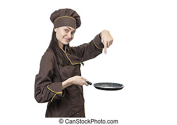 cook points to an empty pan