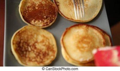 cook prepare breakfast or dessert, fry pancakes on a...