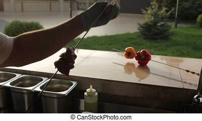 Cook strung pieces of meat on the skewer on the kitchen -...
