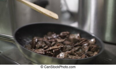 Cook the meat in a frying pan, mixing spatula and tosses in...