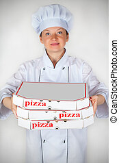 cook with a pizza in box