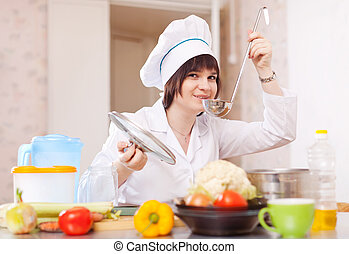 cook woman tasting soup with ladle