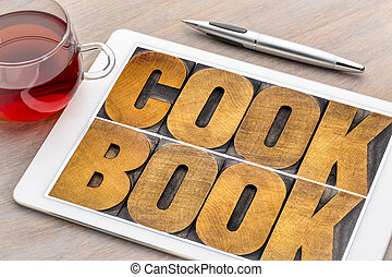 cookbook word abstract in wood type on tablet