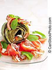 cooked artichoke with tomatoes, parmesan cheese, pancetta, and mint