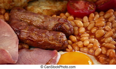 Cooked Breakfast With Sausages, Egg, Beans, Bacon And Hash...