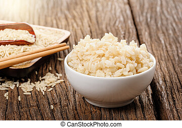 cooked brown rice in white bowl, healthy eating