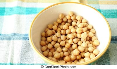 Cooked chickpeas in ceramic bowl. Canned food, chickpea on...