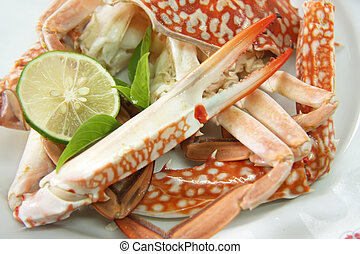 Fresh cooked king crab parts on plate