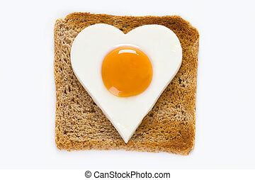 cooked egg on toast - heart shaped cooked egg on a slice of...