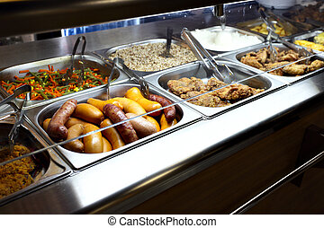 Cooked food - Hot trays with cooked food  in dining room