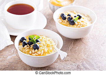 Cooked millet porridge with lemon curd and blueberry