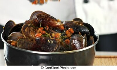 Cooked mussels with vegetables. Steamed clams close up.