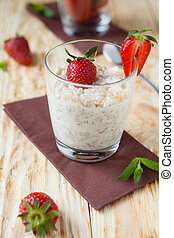 Cooked oatmeal porridge with milk
