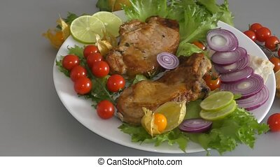 Cooked on grilled pork with fresh herbs