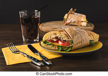 cooked panini on yellow plate and knife with fork