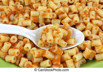 Cooked Pasta With  Sauce On Spoon And Plate Up Close