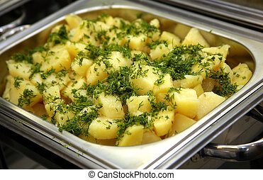 Cooked potato with fennel in a metal saucepan