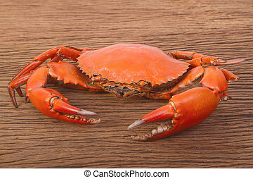cooked red crab on wooden table