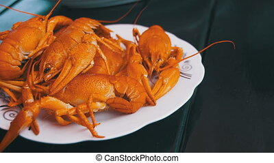 Cooked Red Crayfish on a Wooden Table in the Fish Restaurant...