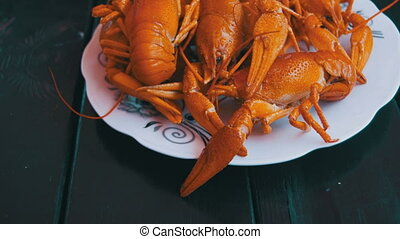 Cooked Red Crayfish on a Wooden Table in the Fish Restaurant