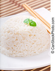 Cooked rice in a white bowl.