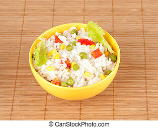 cooked rice in bowl with vegetables