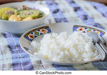 Cooked rice in white dish