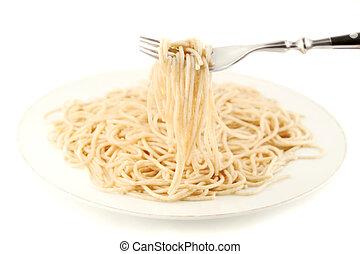 cooked spaghetti - cooked whole wheat spaghetti on white...