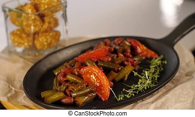 cooked vegetables in a frying pan