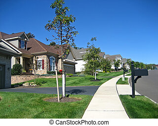 Cookie Cutter Houses on a Suburban Street.