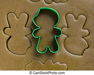 cookie cutter on dough - Green cookie cutter in the top of...