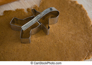 Cookie cutter placed over flattened dough