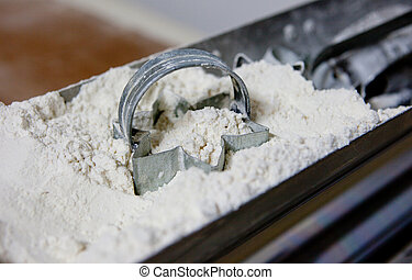 Cookie cutters in flour