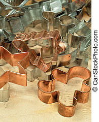 Cookie cutters - Mixed cookie cutters on wooden table.