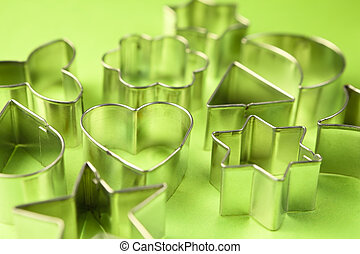 Cookie cutters - Old tin cookie cutters on green paper.