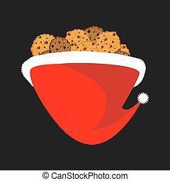 Cookie in Santa cap. Christmas biscuit. Xmas red hat