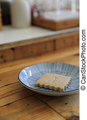 Cookie isolated in wood background