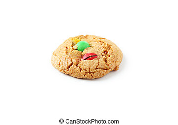 Cookie with colorful candy isolated on white