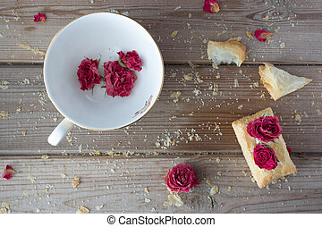cookies and cup with dry roses