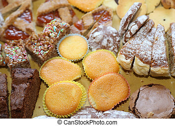 cookies and delicious slices of cake at birthday party -...