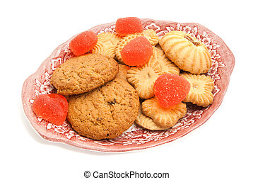 cookies and fruit candy on a dish